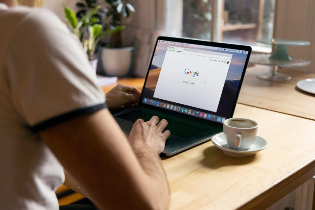 Person browsing Google on their laptop
